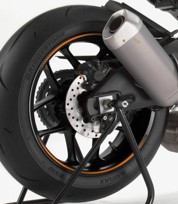 Tira en arco premium naranja flúor Puig para llanta de moto